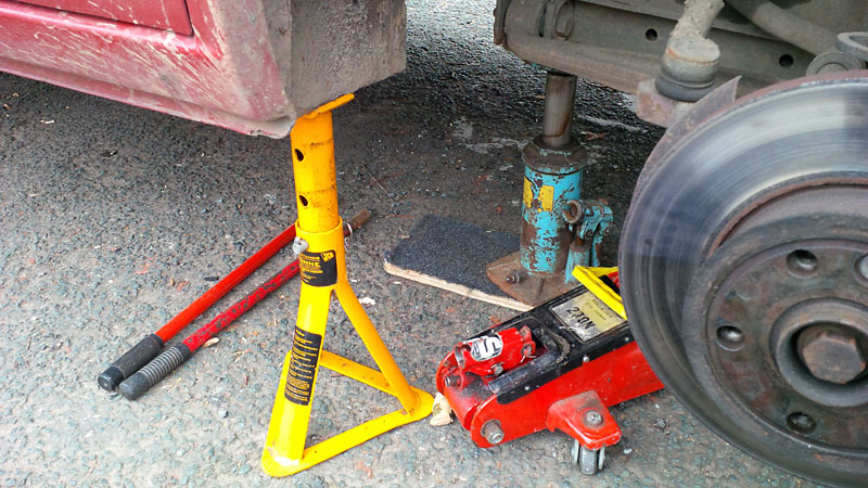 Safety first - always use an axle stand, and I back up with a bottle jack