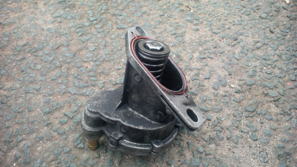 The brake vacuum pump removed from the van