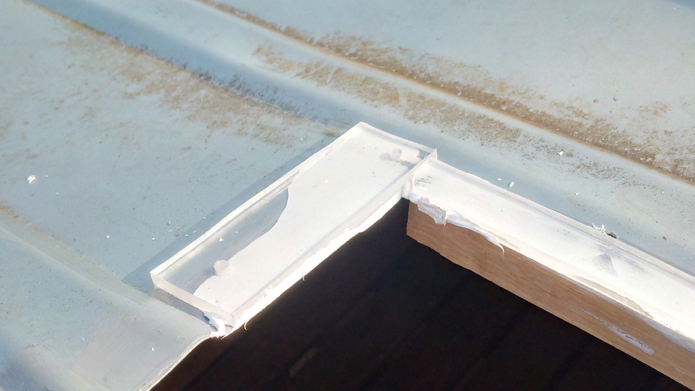 Using Sikaflex 512 to stick the perspex into the roof channels
